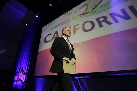 California Governor Jerry Brown walks onstage to speak at the 2014 California Democrats State Convention at the Los Angeles Convention Cente