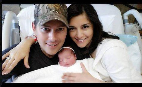 Sean and Rachel Campos Duffy show off their new daughter in a photo they sent by Twitter 5/7/14.