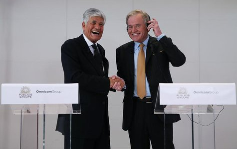 Maurice Levy (L) , French advertising group Publicis Chief executive, and John Wren, head of Omnicom Group react during a joint news confere