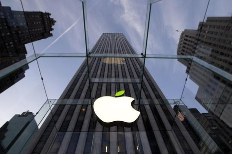 The leaf on the Apple symbol is tinted green at the Apple flagship store on 5th Ave in New York April 22, 2014. Employees and signage have b