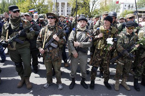 Armed pro-Russia rebels stand guard during celebrations to mark Victory Day in Donetsk, eastern Ukraine May 9, 2014. REUTERS/Marko Djurica