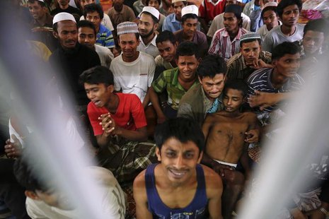 Rohingya people from Myanmar, who were rescued from human traffickers, react in a communal cell at the Songkhla Immigration Detention Centre
