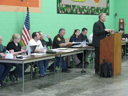 Kevin Soucie, CN Railroad, addresses Junction City crowd