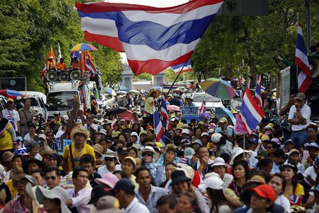 Anti-government protesters wait for their leader Suthep Thaugsuban to come out from the parliament building to address them in Bangkok May 9
