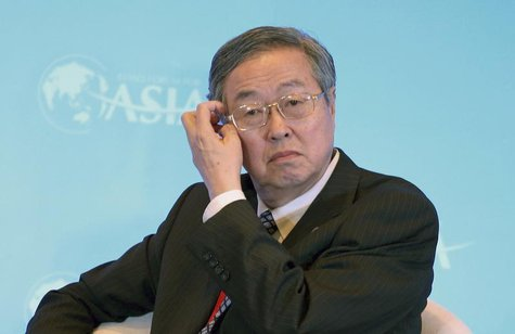 China's central bank Governor Zhou Xiaochuan scratches his head during a session of the Boao Forum for Asia (BFA) Annual Conference 2014, in