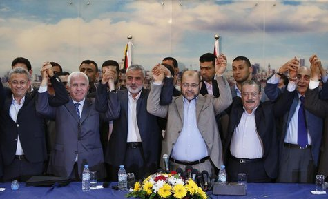 Senior Fatah official Azzam Al-Ahmed (2nd L), head of the Hamas government Ismail Haniyeh (3rd L) and senior Hamas leader Moussa Abu Marzouq