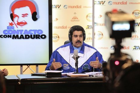 "Venezuela's President Nicolas Maduro speaks during his weekly broadcast ""en contacto con Maduro"" at Miraflores Palace in Caracas, in this Ma"