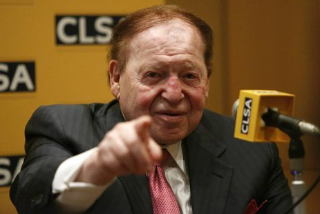 Las Vegas Sands Corp Chairman and Chief Executive Officer Sheldon Adelson points a reporter during a news conference in Tokyo February 24, 2