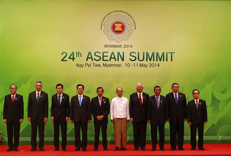 ASEAN leaders pose for pictures during the opening ceremony of the 24th ASEAN Summit in Naypyidaw May 11, 2014. REUTERS/Soe Zeya Tun
