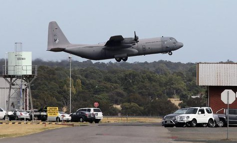 A Royal Malaysia Air Force C-130 takes off from RAAF base Pearce to help search for wreckage and debris of missing Malaysia Airlines Flight