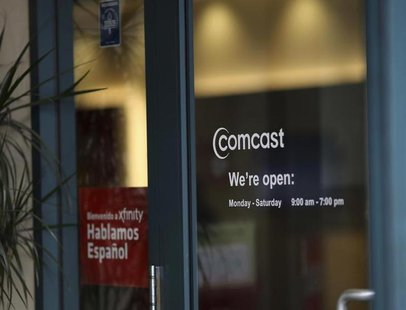 A Comcast sign is shown on the entrance to its store in San Francisco, California February 13, 2014. REUTERS/Robert Galbraith