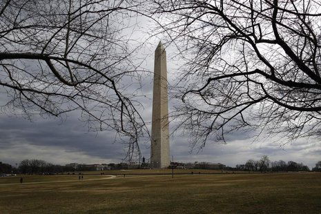 The Washington Monument, currently fenced-in and closed for renovations, is seen in a general view in Washington, March 3, 2013. REUTERS/Jon