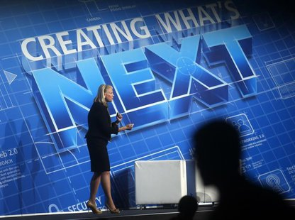 "IBM Chairwoman and CEO Virginia ""Ginni"" Rometty delivers a keynote speech at the Mobile World Congress in Barcelona February 26, 2014. REUTE"