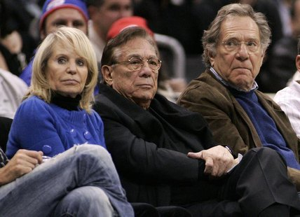 Los Angeles Clippers owner Donald Sterling (C), his wife Shelly (L) and actor George Segal attend the NBA basketball game between the Toront