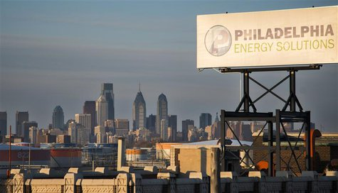 The Philadelphia Energy Solutions oil refinery owned by The Carlyle Group is seen at sunset in front of the Philadelphia skyline March 24, 2