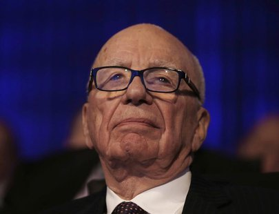 News Corp Chief Executive Rupert Murdoch is pictured in the audience before U.S. President Barack Obama delivered remarks at the Wall Street