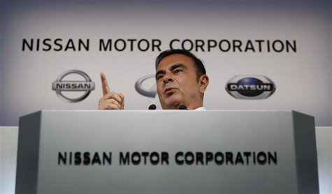 Nissan Motor Co's President and Chief Executive Officer Carlos Ghosn gestures as he speaks at a news conference at its headquarters in Yokoh