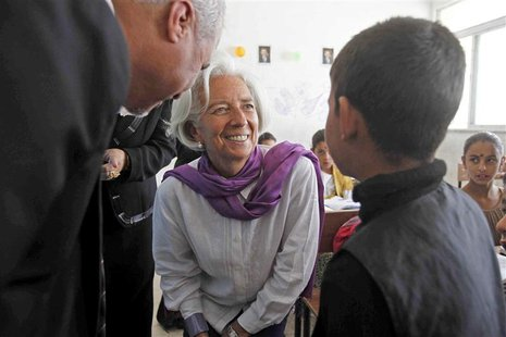 Christine Lagarde (C), International Monetary Fund Managing Director, speaks to a Syrian refugee student at Alimate school in Mafraq in this