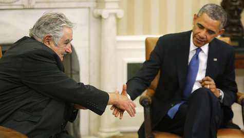 U.S. President Barack Obama (R) reaches out to shake hands as he welcomes Uruguay's President Jose Mujica (L) before their meeting in the Ov