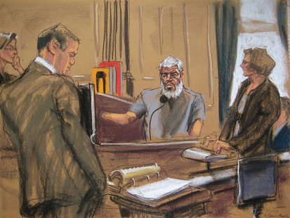 Judge Katherine Forrest (L) looks on as Abu Hamza al-Masri (R), the radical Islamist cleric facing U.S. terrorism charges, replies to questi