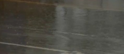 Heavy rain falls in Green Bay (Photo from: FOX 11/YouTube).