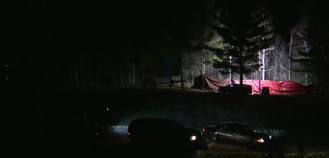 Shawano County Sheriff's investigate the discovery of human remains in the Town of Richmond on Saturday May 10, 2014. (Photo from: FOX 11/YouTube).