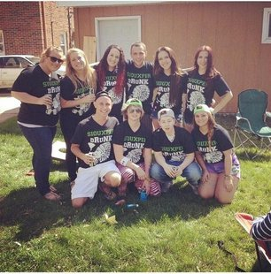 Group of students wearing Siouxper Drunk t-shirts during UND's Springfest celebration