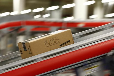 A parcel travels along a belt at the new Marks & Spencer e-commerce distribution centre in Castle Donington, central England May 8, 2013. RE