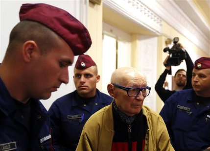 Former Communist Party leader Bela Biszku escorted by police during his trial in Budapest on May 13, 2014. REUTERS/Laszlo Balogh
