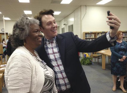 Democratic nominee Clay Aiken takes a pictures with a constituent after a campaign forum in Cary, North Carolina, April 28, 2014. REUTERS/Co