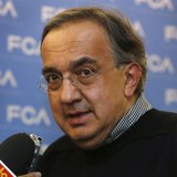 Fiat Chrysler CEO Sergio Marchionne talks to the media during the FCA Investors Day at the Chrysler World Headquarters in Auburn Hills, Mich