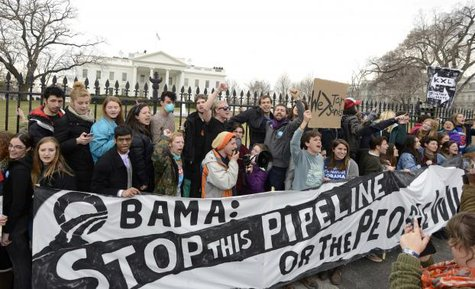 Environmentalists, many of whom have zip-tied themselves to the fence of the White House in Washington, rally and call on U.S. President Barack Obama to reject the Keystone XL pipeline in this March 2, 2014 file photo. Billionaire Tom Steyer's take-no-prisoners stance on Keystone has raised questions about whether he might undercut the party's chance to retain control of the Senate. CREDIT: REUTERS/MIKE THEILER/FILES