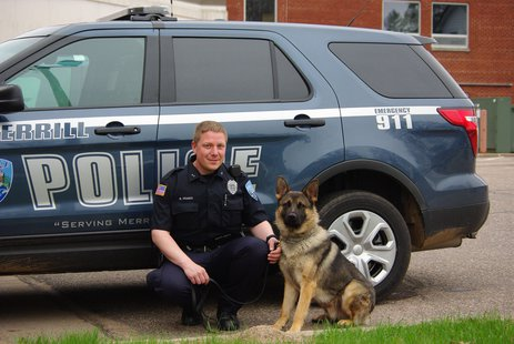 Merrill Police Officer Matt Drabek and Eros  Photo:  Merrill Police Department