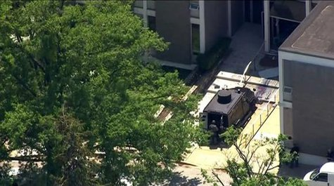 Police tactical team members arrive outside the ABC 2 news station after a possibly armed suspect crashed a vehicle into the Maryland television news station and barricaded himself inside the building, in Towson, Maryland, in this still image taken from video on May 13, 2014. CREDIT: REUTERS/COURTESY-WBAL-TV/HANDOUT VIA REUTERS