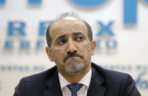 Syrian opposition leader Ahmad Jarba reacts during a news conference in Moscow February 4, 2014. REUTERS/Maxim Shemetov