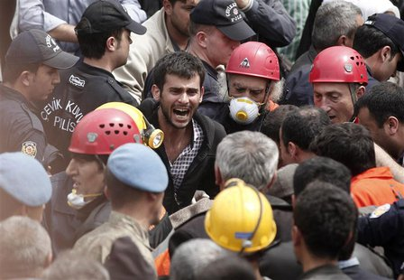 A relative of a miner who was killed or injured in a mine explosion reacts as rescuers work in Soma, a district in Turkey's western province
