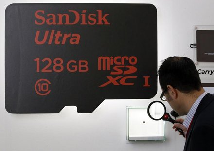 A visitor looks at a SanDisk microSD card at the Mobile World Congress in Barcelona February 25, 2014. REUTERS/Gustau Nacarino