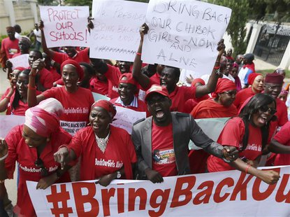 Nigerians take part in a protest demanding for the release of secondary school girls abducted from the remote village of Chibok, in Asokoro,