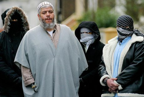 A file photograph dated February 7, 2003 shows Muslim cleric Sheikh Abu Hamza (2L) outside the North London Mosque at Finsbury Park surround