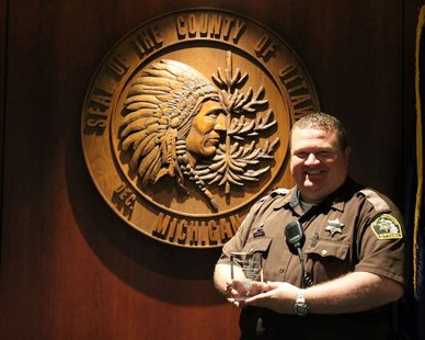 Ottawa Co. Sheriff's Deputy Ben Terpstra with his 2014 First Quarter Outstanding Customer Service Award (photo courtesy Ottawa Co. Government)