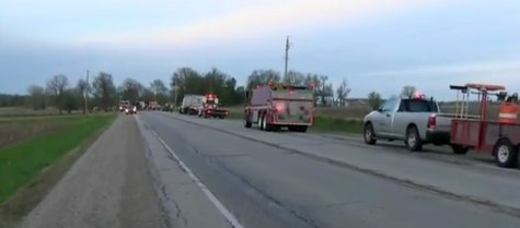Crews respond to scene of overturned semi that spilled tons of meat renderings in the Rosendale area on May 14, 2014. (Photo from: FOX 11/YouTube).