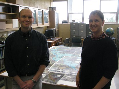 Douglas Miskowiak and Christine Koeller preparing the Stevens Point Flowage bathymetric map for presentation.