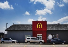 Cars line up at the drive through lane at at a McDonalds Restaurant.   REUTERS/Mark Blinch