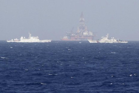 Chinese oil rig Haiyang Shi You 981 (C) is seen surrounded by ships of China Coast Guard in the South China Sea, about 210 km (130 miles) of