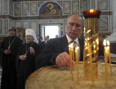 Russian President Vladimir Putin attends an Orthodox service in St. Vladimir's Cathedral in Sevastopol May 9, 2014. REUTERS/Alexei Druzhinin