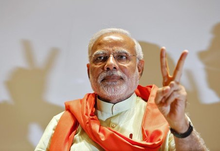 Hindu nationalist Narendra Modi, the prime ministerial candidate for India's main opposition Bharatiya Janata Party (BJP), gestures upon his
