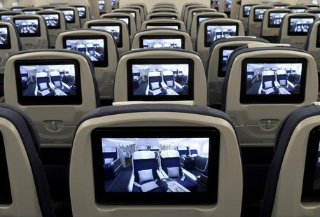 TV screens, installed on board of an Airbus A350 XWB flight-test aircraft are pictured during a media-day at the German headquarters of airc