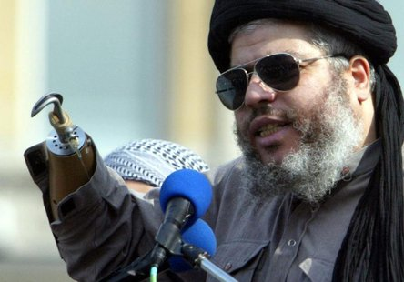 Radical Muslim cleric Sheikh Abu Hamza al-Masri addresses the sixth annual rally for Islam in Trafalgar Square, London, August 25, 2002. REU