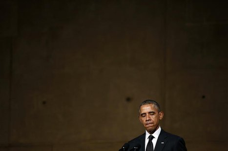 U.S. President Barack Obama speaks during the opening of the National September 11 Memorial Museum in New York May 15, 2014. REUTERS/Kevin L