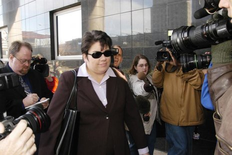 Leslie Caldwell (C), head of the Justice Department's Enron Task Force, arrives at the Federal Courthouse in Houston, January 9, 2004. REUTE